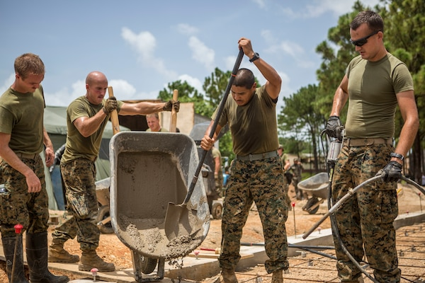 U.S. Marines work together to pour cement into the foundation of the Republica de Cuba School in Puerto Lempira, Honduras, Aug. 17.