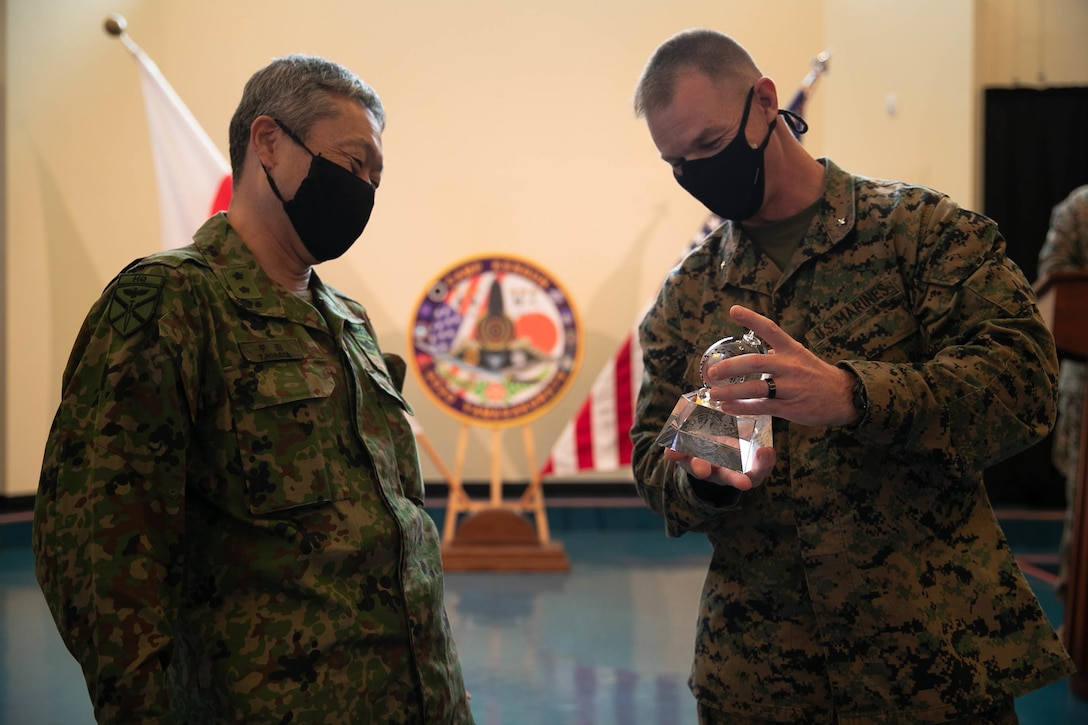 U.S. Marine Corps Brig. Gen. Kyle B. Ellison, commanding general of 3D Marine Expeditionary Brigade, and Maj. Gen. Takanori Hirata recognize service members involved in Exercise Yama Sakura 79 during the closing ceremony on Camp Courtney, Okinawa, Japan, Dec. 14, 2020. YS 79 allows Marines, and their Japanese counterparts to maintain their interoperability, and readiness to respond to any crisis or contingency in the Indo-Pacific region. (U.S. Marine Corps photo by Nickolas Beamish)