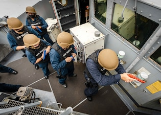 Sailors conduct tactical room-clearing in the pilot house aboard USS John S. McCain (DDG 56).