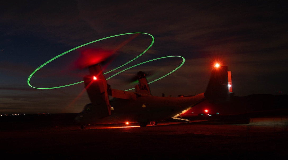 An MV-22 Osprey with Marine Medium Tiltrotor Squadron (VMM) 165 (Reinforced), 11th Marine Expeditionary Unit, stages during a night during a Tactical Recovery of Aircraft and Personnel (TRAP) exercise at Marine Corps Base Camp Pendleton, California, Dec. 16, 2020. The purpose of the exercise was to familiarize the TRAP force with providing immediate response to isolated personnel in potential search and rescue situations, during both day and night scenarios. (U.S. Marine Corps photo by Sgt. Jennessa Davey)