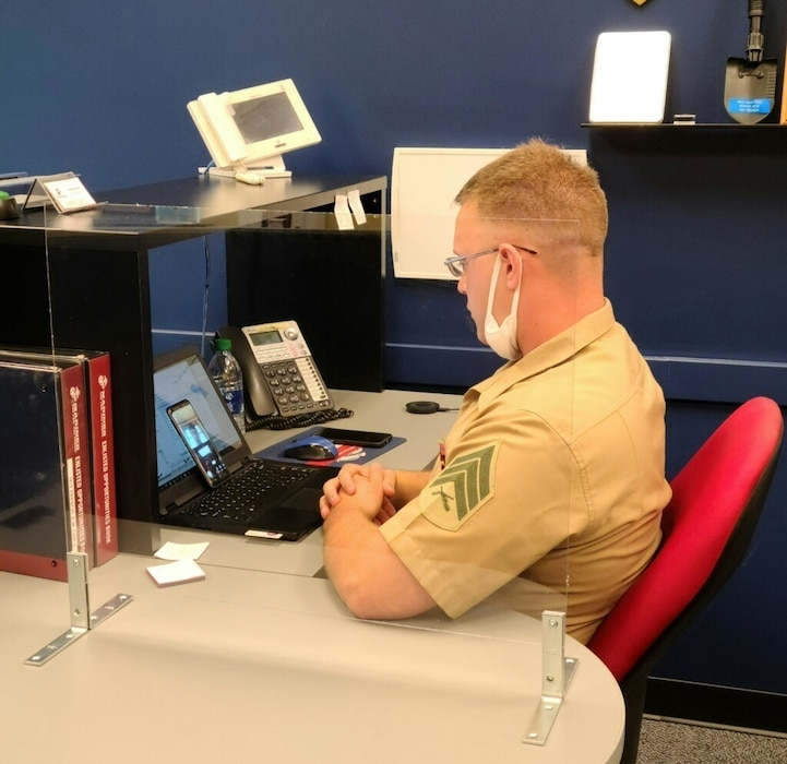 U.S. Marine Corps Sgt. Evan French, a production recruiter, with Recruiting Substation Champaign, Recruiting Station St. Louis conducts a virtual interview with a prospect in Champaign, Illinois on July 28, 2020. During the month of April most of the RSS' stopped area canvasing to look for new prospects to ensure the safety of the recruiters and public. This led them to rely more heavily on phone calls and social media as their tool for communication. (Curtosey Photo)