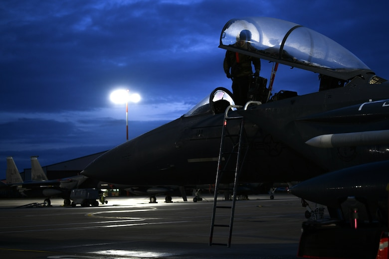 Staff Sgt. Virgil Lawson Jr., 494th Aircraft Maintenance Unit dedicated crew chief, inspects the cockpit of an F-15E Strike Eagle before the first takeoffs of the new year at Royal Air Force Lakenheath, England, Jan. 5, 2021. The 48th Fighter Wing conducts daily flying operations in order to ensure the Liberty Wing can deliver unique air combat capabilities when called upon by its NATO allies. (U.S. Air Force photo by Senior Airman Madeline Herzog)