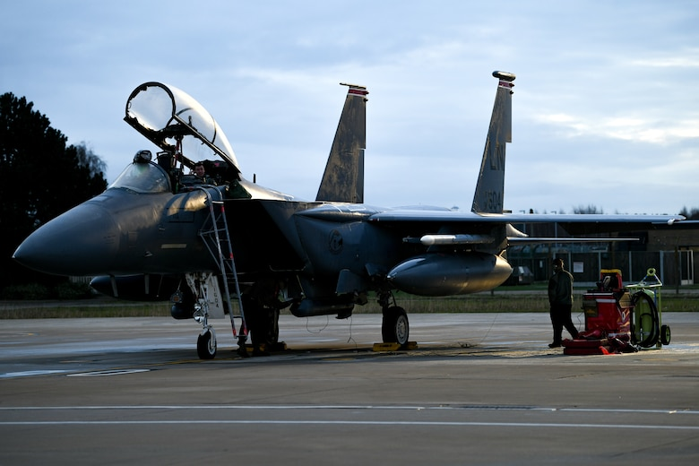 An F-15E Strike Eagle assigned to the 494th Fighter Squadron gets inspected by 494th Aircraft Maintenance Unit Airmen before the first takeoffs of the new year at Royal Air Force Lakenheath, England, Jan. 5, 2021. The 48th Fighter Wing maintains combat readiness through daily training, ensuring the ability to provide superior airpower capabilities in support of United States interests and those of their allies and partners.  (U.S. Air Force photo by Senior Airman Madeline Herzog)