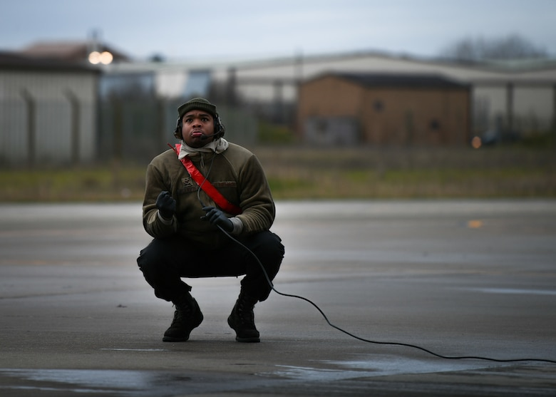 Staff Sgt. Virgil Lawson Jr., 494th Aircraft Maintenance Unit dedicated crew chief, inspects an F-15E Strike Eagle before the first takeoffs of the new year at Royal Air Force Lakenheath, England, Jan. 5, 2021. Dedicated Crew Chiefs are responsible for managing and supervising all maintenance on their respective aircraft by coordinating with other maintenance specialties such as propulsion, hydraulics and fuels to ensure the aircraft is operational in a timely manner. (U.S. Air Force photo by Senior Airman Madeline Herzog)