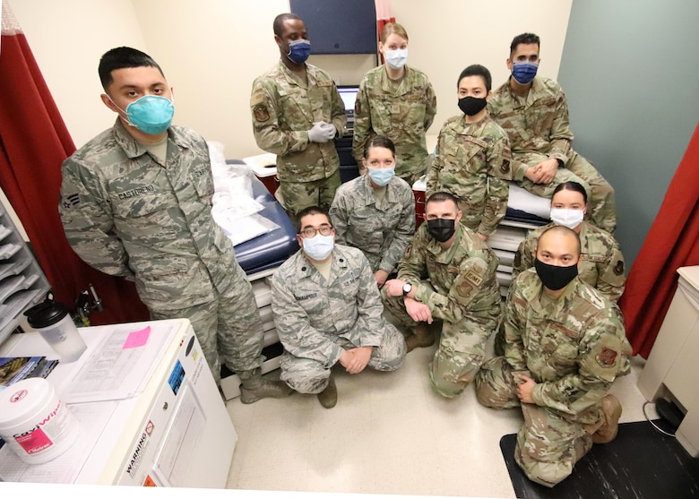 U.S. Airmen with the 673d Medical Group pause for a photo after preparing to administer the COVID-19 vaccine at Joint Base Elmendorf-Richardson, Alaska, Dec. 31, 2020. Upon receiving the initial shipment of the vaccine, JBER began inoculating personnel following the Centers for Disease Control and Prevention's prioritization guidelines. The vaccine is part of Operation Warp Speed, a national initiative to accelerate the development, production and distribution of safe and effective COVID-19 vaccines, therapeutics and diagnostics.