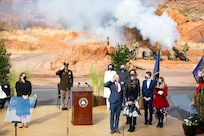 Gov. Spencer J. Cox along with his family stand at attention during a four aircraft flyover by members of 2nd Battalion, 211th General Support Aviation Battalion after Cox took his oath of office at his inauguration ceremony at the Tuacahn Center for the Arts Amphitheatre in Ivins, Utah Jan. 4, 2021.