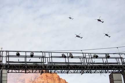 Gov. Spencer J. Cox along with his family stand at attention during a four aircraft flyover by members of 2nd Battalion, 211th General Support Aviation Battalion after Cox took his oath of office at his inauguration ceremony at the Tuacahn Center for the Arts Amphitheatre in Ivins, Utah Jan. 4, 2021