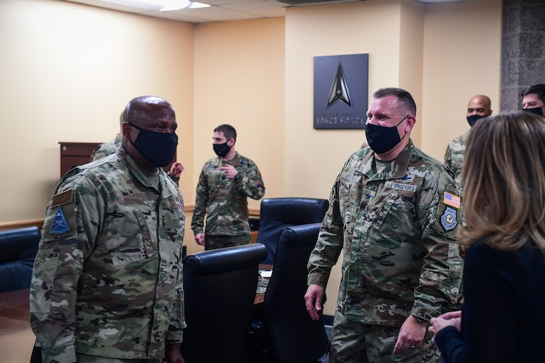 Col. Devin Pepper (left), Buckley Garrison commander, offers his congratulations to Col. Richard Bourquin (right), Space Delta 4 commander, after Bourquin commissioned into the United States Space Force in the DEL 4 conference room at Buckley Air Force Base, Colo., Jan. 5, 2021.