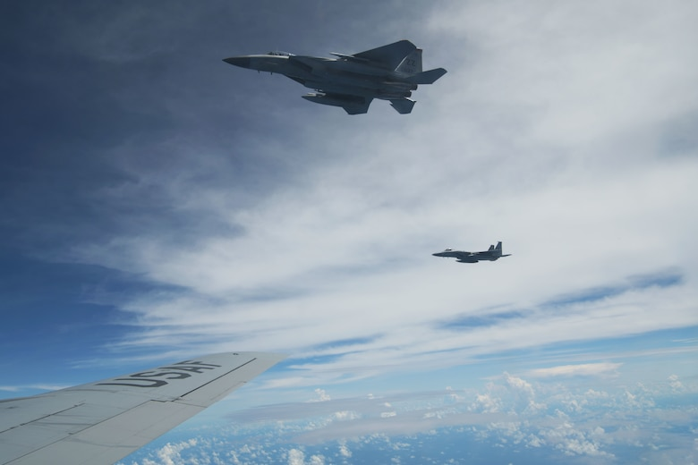 A U.S. Air Force 67th Fighter Squadron F-15C Eagle and a 909th Aerial Refueling Squadron KC-135 Stratotanker prepare to conduct air-to-air refueling during a training exercise July 8, 2020, off the coast of Okinawa, Japan. U.S. Air Forces are postured and ready to respond to crises and contingencies throughout the U.S. Indo-Pacific Command, contributing to regional stability and a free and open Indo-Pacific. (U.S. Air Force photo by Airman 1st Class Rebeckah Medeiros)