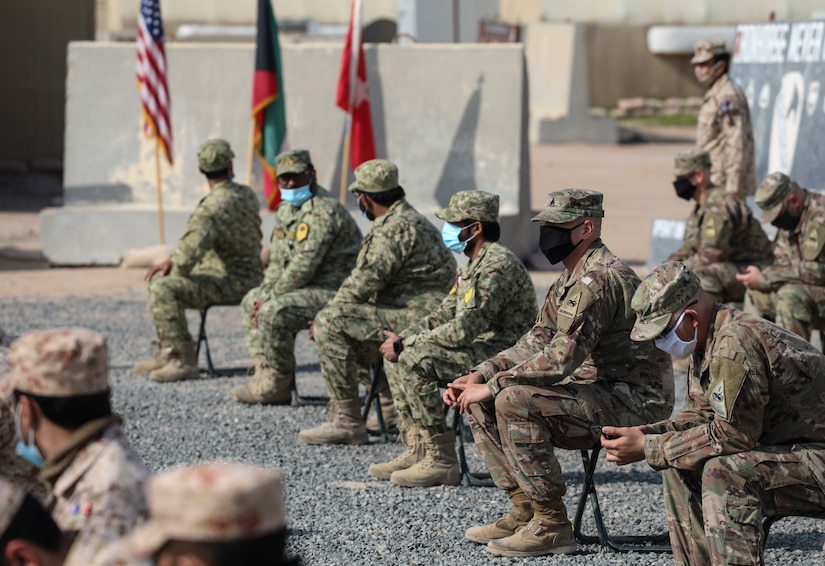 """2nd Armored Brigade Combat Team, 1st Armored Division held a SABOT Academy socially distanced graduation ceremony for Kuwaiti Land Force Soldiers, Kuwaiti National Guardsmen, and Soldiers within the unit, near Camp Buehring, Kuwait on January 5, 2021. """"This course is intended to prepare Soldiers for the rigors of Master Gunner School,"""" said Sgt. 1st Class Jackson Leflar, SABOT Academy instructor and 2ABCT Abrams Bradley fighting vehicle master gunner. """"SABOT Academy was designed more as a crash course and personal assessment of the ability to process and retain the information that is being taught."""" (U.S. Army phot o by: Staff Sgt. Michael West)"""