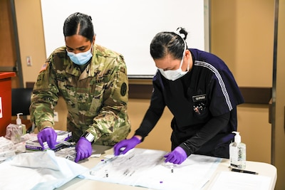 Front line medical workers, Soldiers and law enforcement personnel receive phase one of the COVID-19 vaccination at Fort Hood, Texas Carl R. Darnall Army Medical Center Dec.15, 2020.