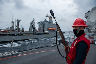 USS Sterett (DDG 104) prepares for a replenishment-at-sea with USNS Yukon (T-AO 202) during.