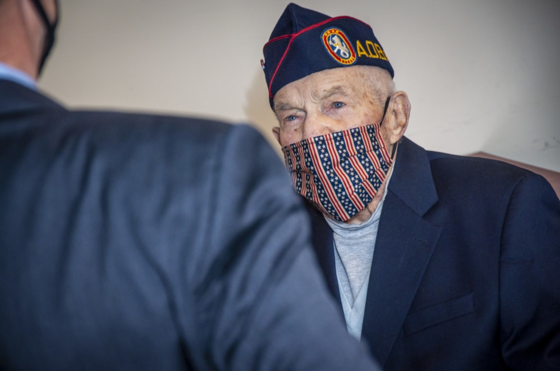 An Army veteran wears a face mask.