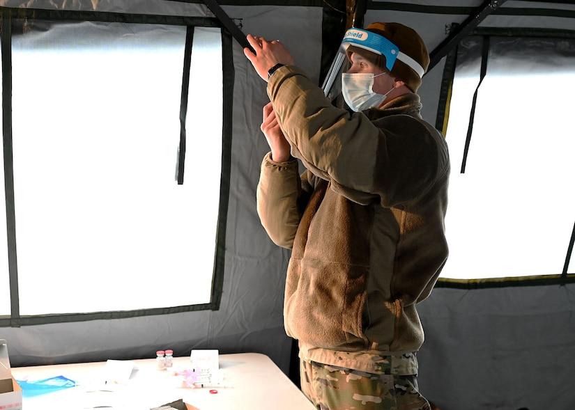 Staff Sgt. Mark Kucal, a medical technician with the 157th Air Refueling Wing, NHANG, draws Moderna COVID-19 vaccine into a syringe at a vaccination site in Lebanon, N.H. on Jan. 5, 2021.