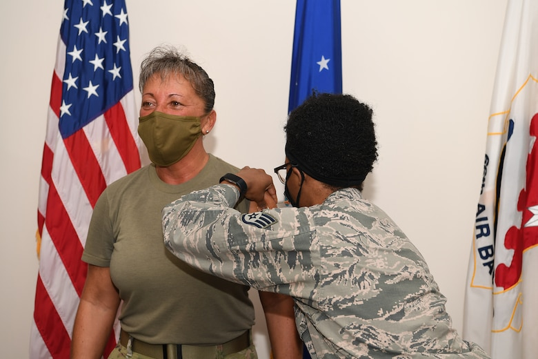 Col. Katrina Stephens, installation commander, receives the influenza vaccine from a 66th Medical Squadron personnel at Hanscom Air Force Base, Mass, late 2020. Officials from the 66 MDS recommend personnel receive a flu shot as soon as possible to protect themselves against illness during the COVID-19 pandemic. (U.S. Air Force photo by Mark Herlihy)