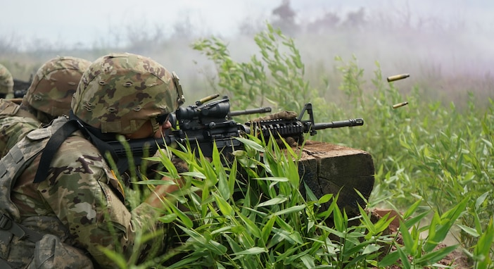 Soldiers from 1st battalion, 109th Infantry Regiment, 2nd Infantry Brigade Combat Team, 28th Infantry Division, work together to move across a course during combined arms live fire training on July 30, 2020, at Fort Indiantown Gap, Pa. Utilizing radio, hand signals, smoke, and more, the leadership of the Soldiers communicated effectively to cross the course while engaging targets.