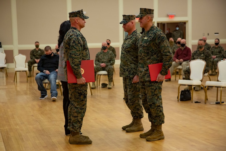 U.S. Marine Corps Sgt. Maj. Charles A. Metzger, left, outgoing sergeant major, Sgt. Maj. Robert M. Tellez, right, incoming sergeant major, and Maj. Gen Julian D. Alford, center, commanding general, all with Marine Corps Installations East-Marine Corps Base Camp Lejeune, participate in a relief and appointment ceremony at Marston Pavilion on MCB Camp Lejeune, North Carolina, Dec. 21, 2020. Metzger, outgoing sergeant major for MCIEAST-MCB Camp Lejeune, relinquished his duties to Tellez and retired after 30 years of honorable service to the Marine Corps. (U.S. Marine Corps photo by Cpl. Ginnie Lee)
