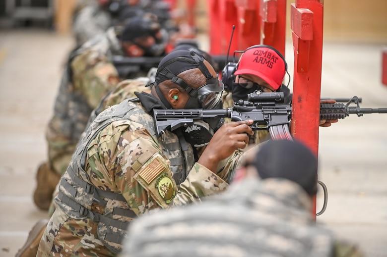 Airman fires rifle.