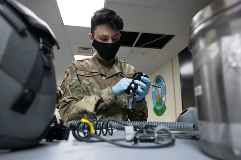 Airman 1st Class Makayla Gibbs, 28th Operation Support Squadron airfield equipment apprentice, cleans and sanitizes headgear for a pilot at Andersen Air Force Base, Guam, in support of a Bomber Task Force mission, Dec. 18, 2020. Aircrew Flight Equipment Airmen are responsible for maintaining the integrity of equipment that pilots use for every mission. (U.S. Air Force photo by Senior Airman Tristan Day)