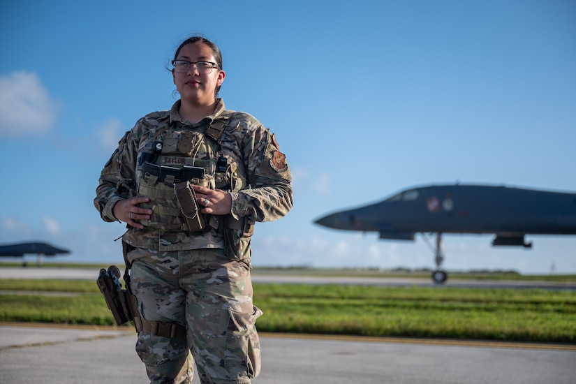 Airman 1st Class Audrey Taylor, 28th Security Forces Squadron response force leader, poses for a photo at Andersen Air Force Base, Guam, in support of a Bomber Task Force mission, Dec. 26, 2020. Security Forces Airmen patrol the flightline to ensure security and guidelines are maintained. (U.S. Air Force photo by Senior Airman Tristan Day)