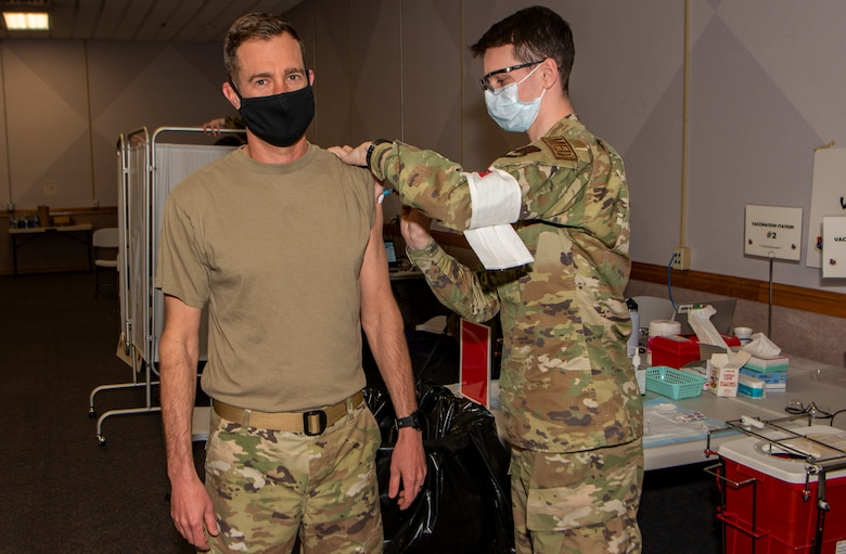 Airman receives a shot in the arm.