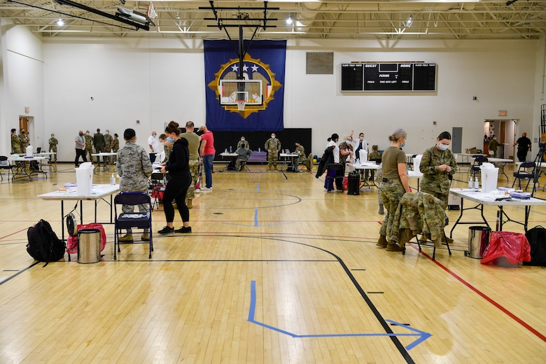 Joint Base McGuire-Dix-Lakehurst, New Jersey, personnel receive COVID-19 vaccines at the Point of Dispensing inside the McGuire Fitness Center Dec. 31, 2020. The 87th Medical Group prioritized those providing direct medical care, emergency services, safety personnel, and deploying forces to receive the vaccine first. (U.S. Air Force photo by Staff Sgt. Jake Carter)
