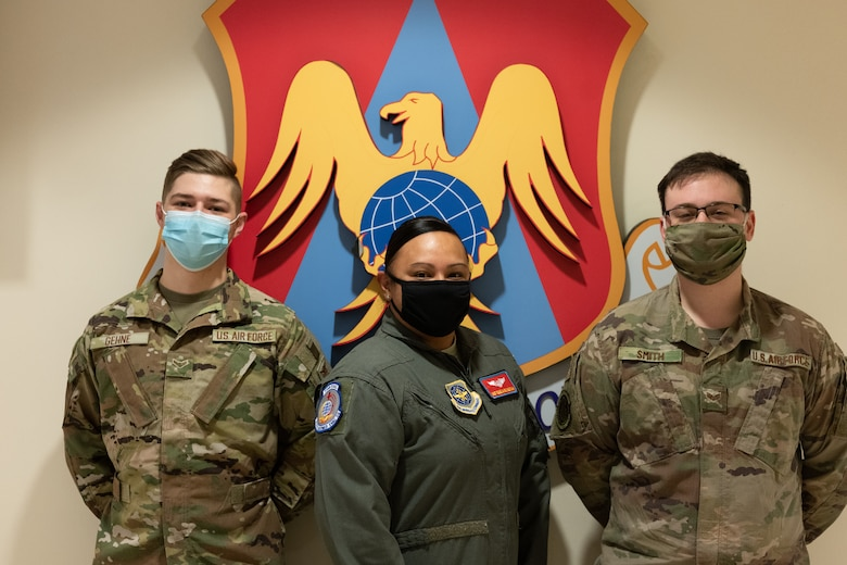 From left: Airman 1st Class James Gehne, 375th Civil Engineer Squadron firefighter, Master Sgt. Renee Cheatham, 375th Aeromedical Evacuation Squadron technician, and Senior Airman Matthew Smith, 375th Security Forces patrolman, are the first three members of Team Scott to receive a COVID-19 inoculation on Scott Air Force Base, Ill., Jan 6, 2021. The Department of Defense prioritizes personnel to receive the vaccines based on Center of Disease Control guidance and the DoD COVID Task Force's assessment of unique DoD mission requirements. The DoD Prioritization Schema prioritizes those providing direct medical care, maintaining essential national security and installation functions, deploying forces and beneficiaries at the highest risk for developing serious illness before other members of the DoD population. (U.S. Air Force photo by Tech. Sgt. Jordan Castelan)
