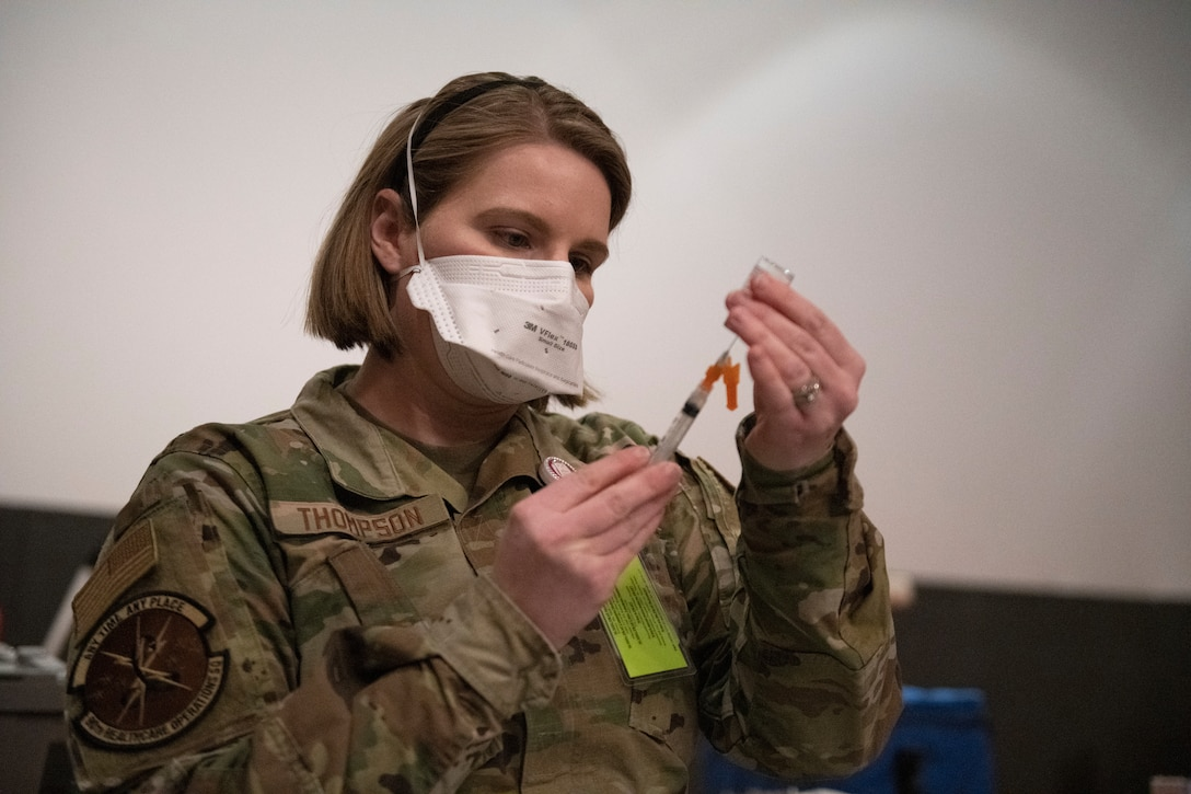 Airman draws out vaccine