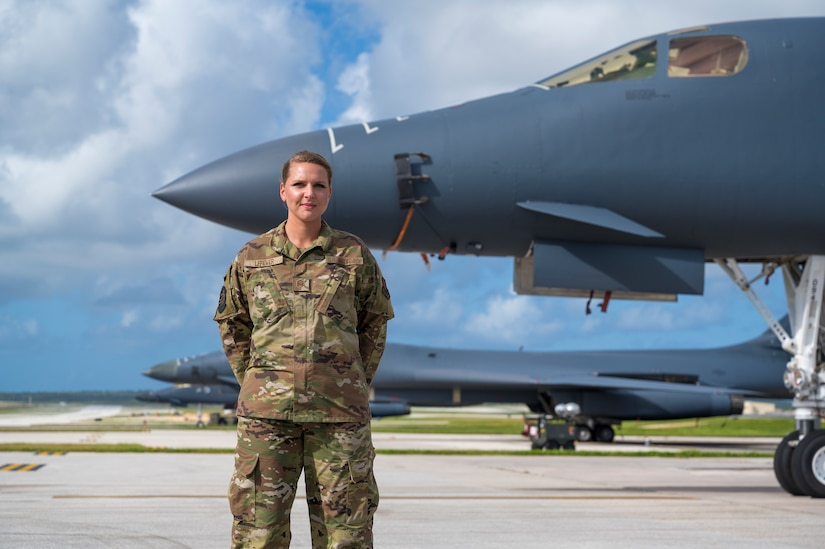 Master Sgt. Erin Lefever, 28th Aircraft Maintenance Squadron Bomber Task Force project officer, poses in front of a U.S. Air Force B-1B Lancer, at Andersen Air Force Base, Guam, in support of a Bomber Task Force mission, Jan. 4, 2021. As the BTF project officer, Lefever coordinates the logistics for the 28th Maintenance Group personnel prior to arrival and throughout the trip, such as cargo prep and any additional coordination with the Andersen team regarding maintenance personnel. (U.S. Air Force photo by Airman 1st Class Austin McIntosh)