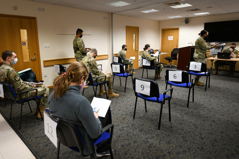 Individuals who have received the COVID-19 vaccine sit and wait for 15 minutes until they are cleared to check out at Royal Air Force Lakenheath, England, Jan. 6, 2021.  Initial vaccines will be limited to healthcare workers, first responders, and other essential personnel to assess the process and will be used to plan an expanded distribution phase, where each service will request and administer the vaccine through a Defense Department wide phased vaccination approach.  (U.S. Air Force photo by Senior Airman Madeline Herzog)
