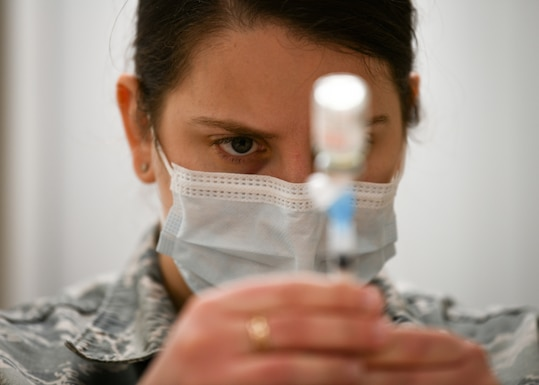 U.S. Air Force Staff Sgt. Anna Murray, 48th Medical Group immunizations technician, draws the COVID-19 vaccine from a vial at Royal Air Force Lakenheath, England, Jan. 6, 2021. Initial vaccines will be limited to healthcare workers, first responders, and other essential personnel to assess the process and will be used to plan an expanded distribution phase, where each service will request and administer the vaccine through a Defense Department wide phased vaccination approach. (U.S. Air Force photo by Senior Airman Madeline Herzog)