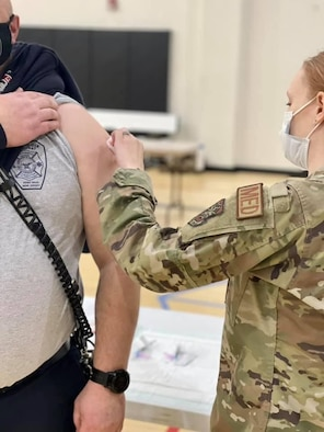 A member of the Joint Base McGuire-Dix-Lakehurst community receives the first dose of the COVID-19 vaccine Jan. 6, 2021. Members of the 514th Air Mobility Wing are scheduled to receive the vaccine over the January UTA. (U.S. Air Force photo by Daniel Pensiero)