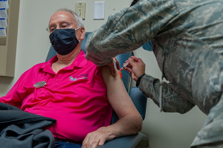 Photo of an Airman receiving a vaccine