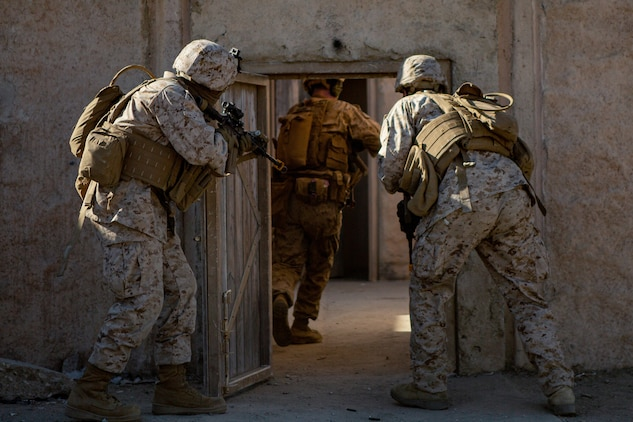 U.S. Marines with 1st Intelligence Battalion, I Marine Expeditionary Force Information Group, clear a building during a CounterIntelligence and Human Intelligence Tactical Exercise at Marine Corps Base Camp Pendleton, California, Oct. 16, 2020. The CI/HUMINT TACEX integrates infantry and intelligence Marines to improve proficiency and readiness when deployed.. (U.S. Marine Corps photo by Lance Cpl. Ian M. Simmons)