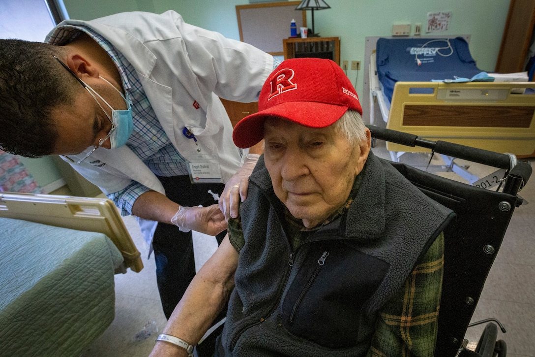 An older man gets vaccinated.