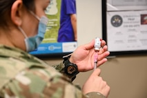 A medic from the 2nd Medical Group prepares to administer the COVID-19 vaccination at Barksdale Air Force Base, La., Jan. 6, 2021. Barksdale is following the Department of Defense's deliberate and phased approach to distribute and administer the vaccination. (U.S. Air Force photo by Senior Airman Christina Graves)