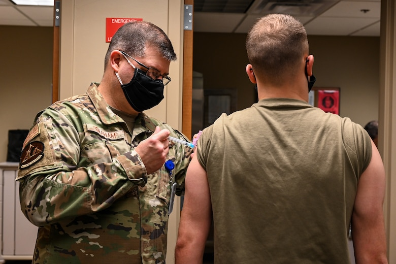 Airmen from the 2nd Medical Group receive the first doses of the COVID-19 vaccination at Barksdale Air Force Base, La., Jan. 6, 2021. Vaccination distribution prioritization within the Department of Defense will be consistent with data-driven guidance from the Centers for Disease Control and Prevention. (U.S. Air Force photo by Senior Airman Christina Graves)
