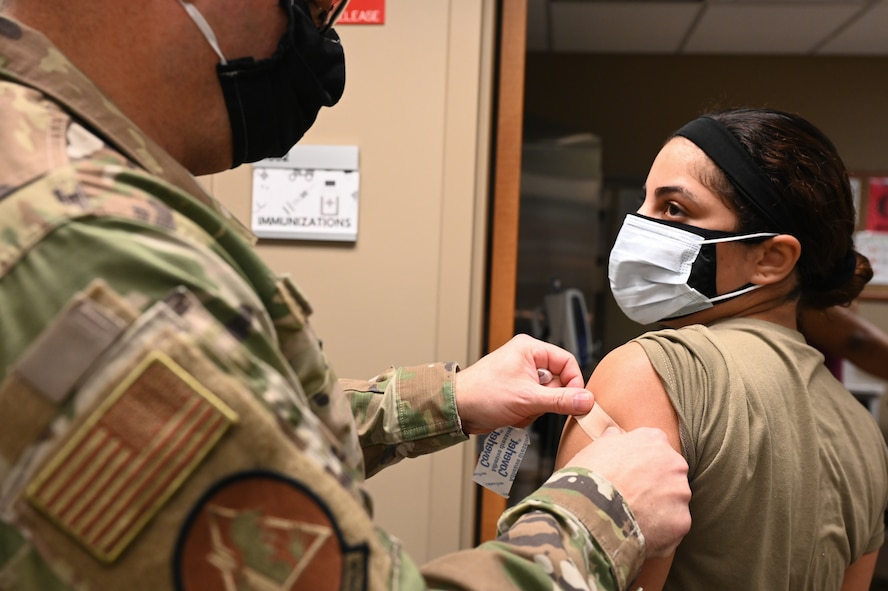 Airmen from the 2nd Medical Group receive the first doses of the COVID-19 vaccination at Barksdale Air Force Base, La., Jan. 6, 2021. Vaccines authorized for emergency use (EUA) are offered on a voluntary basis. (U.S. Air Force photo by Senior Airman Christina Graves)