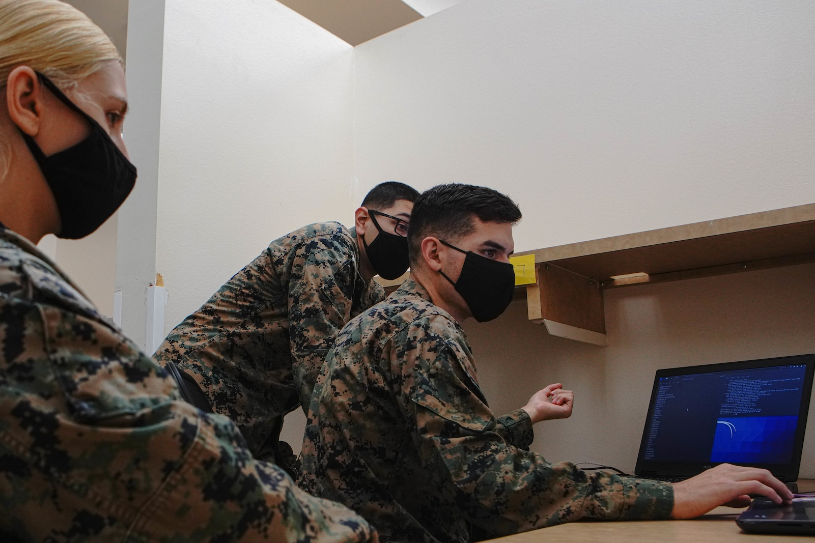 U.S. Marine Corps Lance Cpl. Ian Bergman, middle, a defensive cyberspace operator, Lance Cpl. Enrique Medina, right, a defensive cyberspace operator, and Cpl. Bethany Leer, left, an intelligence analyst with 9th Communication Battalion, I Marine Expeditionary Force Information Group, hack into a system while engaged in the Marine Corps 2020 Cyber Games at Marine Corps Base Camp Pendleton, California, Nov. 19, 2020. 9th Comm participated in the cyber games to enhance their skills and to develop tactics and techniques while competing against other teams across the United States. (U.S. Marine Corps photo by Lance Cpl. Patrick Katz)