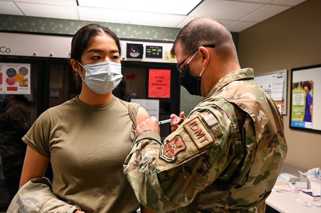 Airmen from the 2nd Medical Group receive the first doses of the COVID-19 vaccination at Barksdale Air Force Base, La., Jan. 6, 2021. The Department of Defense remains committed to protecting all service members, civilian employees, and families around the globe. (U.S. Air Force photo by Senior Airman Christina Graves)