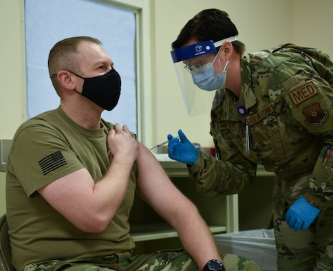 Service member receives COVID 19 vaccine