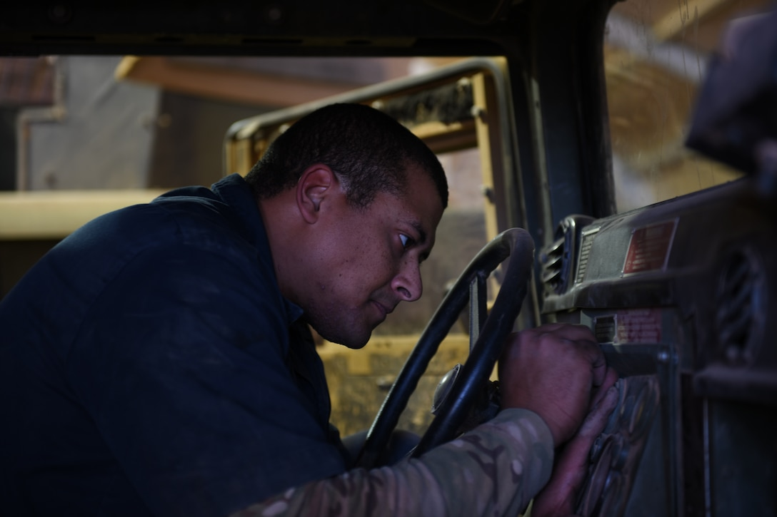 U.S. Air Force Staff Sgt. Joshua Poole, 724th Expeditionary Air Base Squadron noncommissioned officer in charge of materiel management, places a control panel inside a Humvee, at Nigerien Air Base 201, Agadez, Niger, Jan. 4, 2021. Materiel management consists of continuing actions relating to planning, organizing, directing, coordinating, controlling, and evaluating the application of resources to ensure the effective and economical support of military forces. (U.S. Air Force photo by Senior Airman Gabrielle Winn)