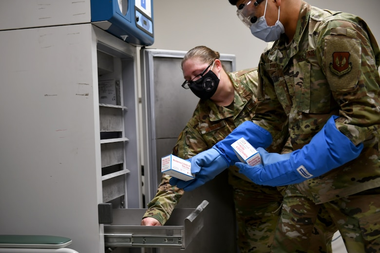 U.S. Air Force Senior Airman Siejeay Dimla, 31st Medical Support Squadron medical logistics technician, right, and Staff Sgt. Carol Hubbard, 31st Health Care Operations Squadron immunizations technician, left, place boxes of Moderna COVID-19 vaccines inside a freezer at Aviano Air Base, Italy, Jan. 7, 2021. Initial quantities of the vaccine are limited and will be distributed on a rolling delivery basis as more vaccines become available. (U.S. Air Force photo by Staff Sgt. K. Tucker Owen)