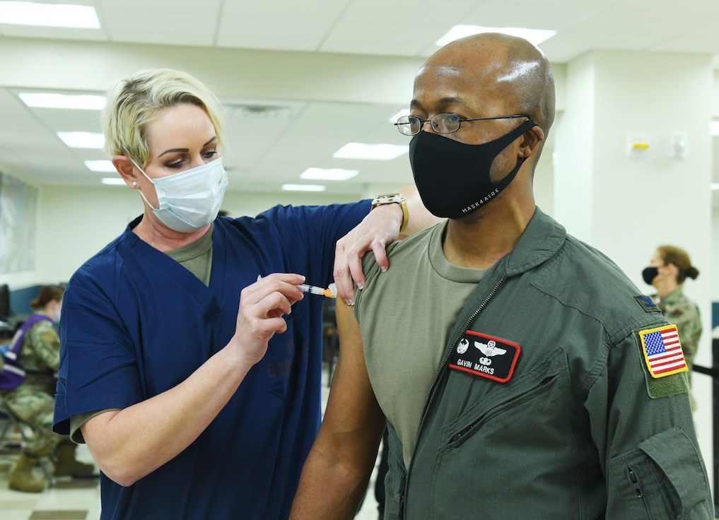A photo of Offutt members receiving the COVID-19 vaccine.