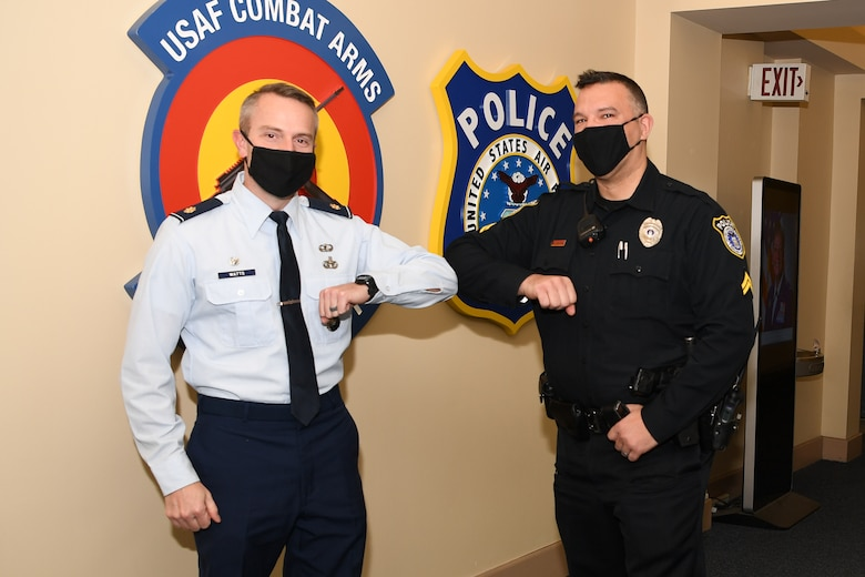 Maj. Shane Watts, 66th Security Forces Squadron commander, bumps elbows with Cpl. Bernardino Coelho, 66 SFS lead police officer, at Hanscom Air Force Base, Mass., Jan. 4. Coelho was recently named the 2020 Flight Level Civilian Employee (Supervisor) for the security forces career field. (U.S. Air Force photo by Mark Herlihy)