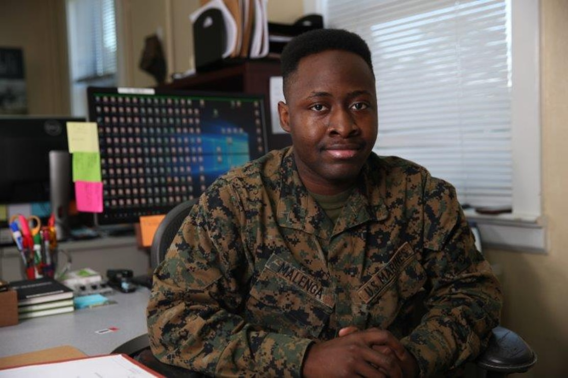 "Lance Cpl. Muya M. Malenga, a administrative specialist/legal clerk with Head Quarters Company, 2d Marine Regiment, 2d Marine Division, poses for a photo on Camp Lejeune, N.C., January, 7, 2021. ""Courage is not having the strength to go on, it is going on when you do not have the strength,"" said Malenga, a Las Vegas, NV, native. According to his leadership, Malenga has been an asset since his arrival. LCpl Malenga ensures his duties are completed to the best of his ability and takes personal pride in the quality of his work and attention to detail.  Although legal is one of the busiest sections within the S1, any time LCpl Malenga does have, he utilizes to ask questions and cross train with his peers in order to grow within his field.  As a result, he has been able to more efficiently track and process over 150 administrative separations, command investigations, NJPs, and courts martials.  LCpl Malenga is a trustworthy team player who is always ready and willing to cover down for his team in any capacity he is needed while maintaining an enthusiastic positive attitude and uplifting everyone around him. (U.S. Marine Corps photo by Lance Cpl. Jennifer E. Reyes)"