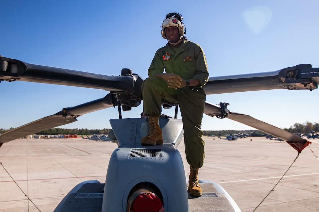 "Sgt. Jamir K. Smith, an avionics technician with Marine Light Attack Helicopter Squadron 167, Marine Aircraft Group 29, 2nd Marine Aircraft Wing, poses for a photo at Marine Corps Air Station New River, N.C. , November 17, 2020. ""It's better to be prepared for an opportunity and not have one, than have an opportunity and not be prepared,"" said Smith, a Brooklyn, N.Y., native. According to his leadership, Smith's guidance resulted in 689 maintenance action form sign-offs, accounting for over 3,149 maintenance man-hours completed with in the avionics department. (U.S. Marine Corps photo by Lance Cpl. Elias E. Pimentel III)"