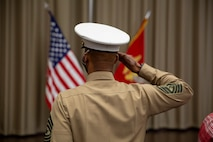 U.S. Marine Sgt. Maj Chester Wilson III salutes the flag during the playing of the national anthem as part of a relief and appointment ceremony at the Defense Logistics Agency, New Cumberland, Pennsylvania, Dec. 22, 2020. Sgt. Maj. Kenneth. L. Kuss took over  the 4th Marine Corps District seanior enlisted advisor position from Wilson. (U.S. Marine Corps photo by Gunnery Sgt. Valerie Nash)