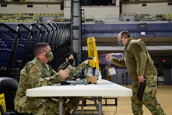 Guard members in-process at the D.C. Armory on Jan. 7, 2021. National Guard Soldiers and Airmen from several states have traveled to the National Capital Region to provide mission support to federal and district authorities.