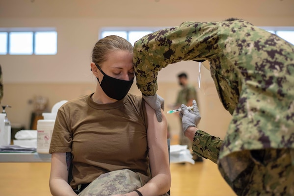 A Sailor assigned to the U.S. Navy�s only forward-deployed aircraft carrier, USS Ronald Reagan (CVN 76), receives the COVID-19 vaccine on Commander, Fleet Activities Yokosuka (CFAY).